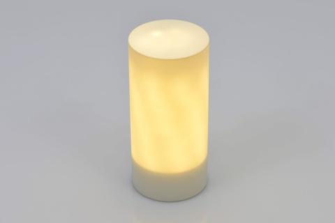 照明器具の「LUX」は持ち運んで使用でき、本体を回転させることで明るさを変えられる。材質はアクリルやABS樹脂、ウレタン。価格は2万1400円ぐらいを予定