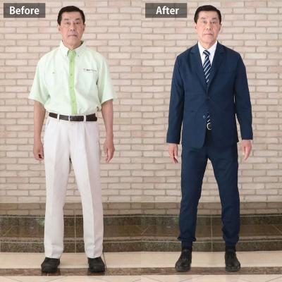 ワークウェアスーツを着た三菱地所コミュニティの管理人の例。以前の姿より高級感がある