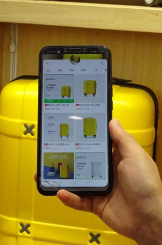 アプリで商品を読み込むと、Tモール上の同一商品のページを自動的に示す