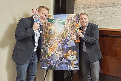 <b>(左)ジャレド・ブッシュ氏</b><br>アカデミー賞監督ロバート・ゼメキスのスクリプト・リーダーとしてキャリアをスタート。コロンビア、20世紀フォックスにて長編映画の企画などを手がけ、ディズニーではアニメ専門チャンネル「ディズニーXD」のコメディ・アドベンチャー・シリーズ「Penn Zero: Part-Time Hero」(14~15年)の共同クリエイターと製作総指揮とライターを務めた。『ズートピア』では脚本家および共同監督として、作品のベースとなる世界観やキャラクターの性格、ストーリーの全体像を形作る責務を負っている。<br><b>(右)クラーク・スペンサー氏</b><br>90年、財務&プラニング部門のシニア・ビジネス・プランナーとしてディズニーに加入。その後20年以上にわたり、ウォルト・ディズニー・アニメーション・スタジオの様々なエグゼクティブの役割を経験する。プロデューサーを務めた長編映画は、『リロ&スティッチ』(03年)『ボルト』(09年)『シュガー・ラッシュ』(13年)『ズートピア』の4作品。『シュガー・ラッシュ』では、アメリカ・プロデューサー組合賞にて最優秀アニメーション映画賞を獲得している
